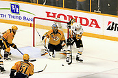 June 5th 2017, Nashiville, TN, USA;  Pittsburgh Penguins center Jake Guentzel (59) tries to control the puck in front of Nashville Predators goalie Pekka Rinne (35) during Game 4 of the Stanley Cup Final between the Nashville Predators and the Pittsburgh Penguins, held on June 5, 2017, at Bridgestone Arena in Nashville, Tennessee.
