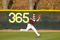 Center fielder Cole Rakar #12 of the College of Charleston Cougars makes a running catch against the Davidson Wildcats at Wilson Field on March 12, 2011 in Davidson, North Carolina.  The Wildcats defeated the Cougars 8-3.  Photo by Brian Westerholt / Four Seam Images