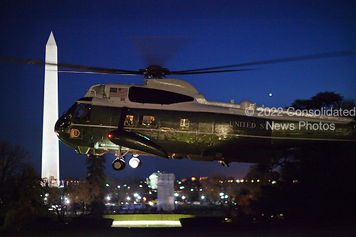 Washington, DC - December 1, 2009 -- United States President Barack Obama can be seen reading through the window as Marine One lifts off from the South Lawn of the White House en route to Andrews Air Force Base, before heading to West Point, Monday, December 1, 2009. .Mandatory Credit: Chuck Kennedy - White House via CNP