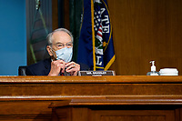 United States Senator Chuck Grassley (Republican of Iowa) adjusts his protective face mask prior to the United States Senate Committee on Finance hearing regarding the inspection process of foreign drug manufacturing on Capitol Hill in Washington D.C., U.S., on Tuesday, June 2, 2020.  Credit: Stefani Reynolds / CNP/AdMedia