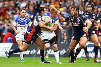 PICTURE BY ALEX WHITEHEAD/SWPIX.COM - Rugby League - Super League Play-Off - Warrington Wolves vs St Helens - The Halliwell Jones Stadium, Warrington, England - 15/09/12 - Warrington's Chris Riley is tackled by St Helens' Anthony Laffranchi.
