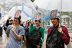 Apple fans wait outside the Apple Store to get the new iPhone XS, iPhone XS Max or iWatch (Series 4) in Omotesando on September 21, 2018, Tokyo, Japan. Apple fans lined up patiently in the early morning rain to get the new iPhone models (XS and XS Max) and the new iWatch (Series 4). The new iPhone XS costs JPY 112,800 for the 64 GB model, the iPhone XS Max costs JPY 124,800 JPY for the 64 GB model, and iWatch Series 4 costs JPY 45,800. (Photo by Rodrigo Reyes Marin/AFLO)