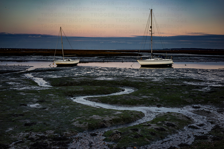 river estruary in England with small yacht at early evening