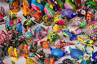 Oaxaca, Mexico, North America.  Alebrijes, whimsical colored animals carved from copal wood.
