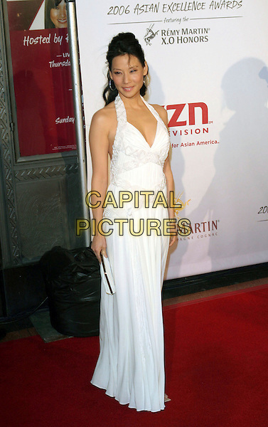 LUCY LIU.The 2006 Asian Excellence Awards, Los Angeles, California..January 19th, 2006.Photo: Zach Lipp/AdMedia/Capital Pictures.Ref: ZL/ADM.full length white dress halterneck clutch purse.www.capitalpictures.com.sales@capitalpictures.com.© Capital Pictures.
