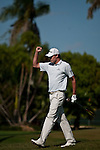 DORAL, FL. - Nick Watney pumps his fist after making his chip shot from the gallery on hole 9 during final round play at the 2009 World Golf Championships CA Championship at Doral Golf Resort and Spa in Doral, FL. on March 15, 2009