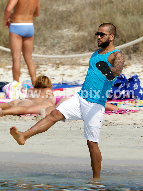 **ALL ROUND PICTURES FROM SOLARPIX.COM**                                             **WORLDWIDE SYNDICATION RIGHTS EXCEPT SPAIN - NO SYNDICATION IN SPAIN**                                                                                  Caption: Brazilian footballer Daniel Alves da Silva who currently plays for FC Barcelona, commonly known as Dani Alves, with his wife Dina and his young children -  son Daniel and daughter Victoria - enjoying a holiday on the spanish island of Formentera.                                                                             This pic: Dani Alves                                                                                               JOB REF: 13780 DGM       DATE: 27_07_2011                                                           **MUST CREDIT SOLARPIX.COM OR DOUBLE FEE WILL BE CHARGED**                                                                      **MUST AGREE FEE BEFORE ONLINE USAGE**                               **CALL US ON: +34 952 811 768 or LOW RATE FROM UK 0844 617 7637**