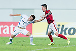 Guangzhou Defender Zhang Linpeng (R) fights for position with Kashima Forward Suzuki Yuma (L) during the AFC Champions League 2017 Round of 16 match between Guangzhou Evergrande FC (CHN) vs Kashima Antlers (JPN) at the Tianhe Stadium on 23 May 2017 in Guangzhou, China. (Photo by Power Sport Images/Getty Images)