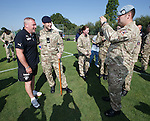Rangers army visit in Germany - Ally McCoist poses for pictures with the soldiers
