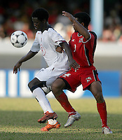 09 February, 2005. USMNT forward Eddie Johnson (9) holds off  Trinidad and Tobago's Marlon Rojas (2) during the World Cup qualifier at Queen's Park Oval in Port of Spain, Trinidad and Tobago.  The USMNT defended Trinidad and Tobago 2-1.