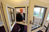 this image is FREE to USE - Alex Neil - Cabinet Secretary for Infrastructure and Capital Investement - photographed (with latest technology triple glazing sample) at Aurora House (the South Lanarkshire College specialist Eco-house) at the start of the Greener Homes Summit being hosted at the College today. Mr Neil welcomed representatives from Scotland's house-building industry and financial institutions to discuss how to provide more affordable eco-friendly homes in Scotland - for further information please contact Iain V Monk - Scottish Government Senior Communications Officer - on 07771 555 601 - picture by Donald MacLeod  23.11.11  clanmacleod@btinternet.com 07702 319 738 donald-macleod.com