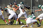 Palos Verdes, CA 10/25/13 - Jake Fideler (Mira Costa #86) and Andrew Phillips (Peninsula #16) in action during the Mira Costa vs Peninsula varsity football game at Palos Verdes Peninsula High School.