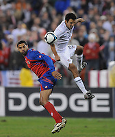 USMNT defender Jonathan Bornstein (12)  heads the ball against Costa Rica forward Alvoro Saborio.  The USMNT tied Costa Rica 2-2 on the final game of the 2010 FIFA World Cup Qualifying round at RFK Stadium, Wednesday October 14, 2009.
