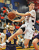 Jack Phalen #5 of Cold Spring Harbor makes an acrobatic move during a Nassau County varsity boys basketball game against Oyster Bay at Cold Spring Harbor High School on Monday, Jan. 16, 2017. Cold Spring Harbor won by a score of 72-45.