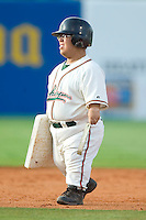 Greensboro's bat boy helps change the bases between innings of the Grasshoppers game versus Hickory at First Horizon Park in Greensboro, NC, Thursday, June 8, 2006.  Hickory defeated Greensboro 5-4 in 8 innings.