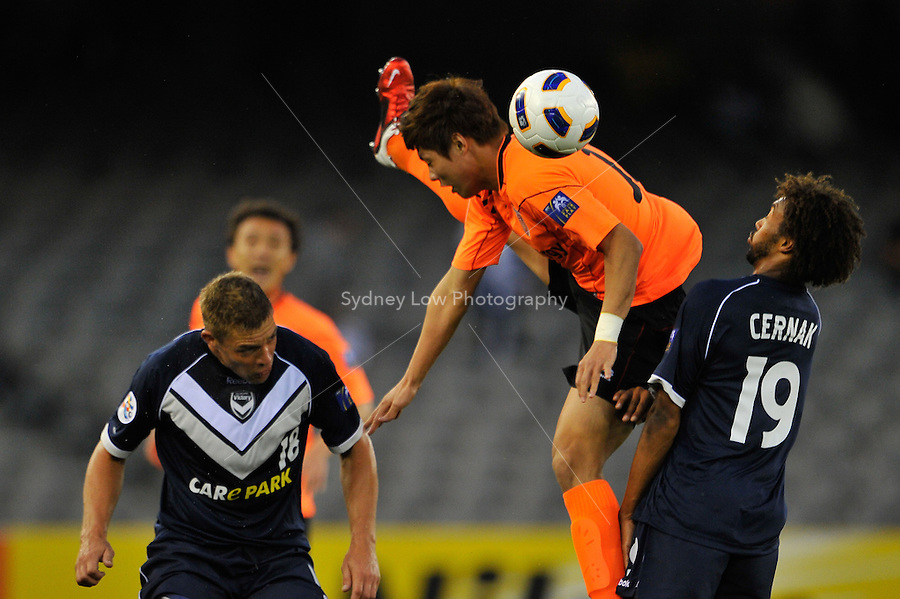 HONG JEONGHO from Jeju United jumps acrobatically to head the ball during the AFC Champions League Group E match between the Melbourne Victory and Jeju United at Etihad Stadium in Melbourne, Australia.