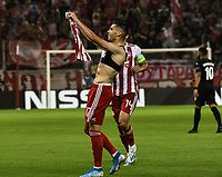 Olympiakos's Ranđelović celebrate his second goal  and third  of his team during the UEFA Champions League playoff first leg soccer match between Olympiakos and Krasnodar at Karaiskaki stadium in Piraeus, Greece, on 21 August 2019
