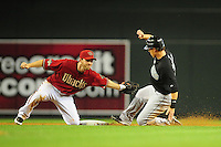 Jun. 1, 2011; Phoenix, AZ, USA; Arizona Diamondbacks shortstop Stephen Drew tags out Florida Marlins base runner Chris Coghlan in the seventh inning at Chase Field. Mandatory Credit: Mark J. Rebilas-