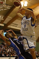 St Pats' Brook Ruscoe-Taiaroa fouls Poutuuterangi Edwards during the NZ Secondary Schools Basketball Championships match between Fraser High School and St Patricks College at Arena Manawatu, Palmerston North, New Zealand on Saturday 4 October 2008. Photo: Dave Lintott / lintottphoto.co.nz