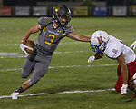 Galena #3 Mateo Lemus straight-arms the Reno defender and runs down the sideline in their football game played on Friday night Sept. 16, 2016 at Galena High School.