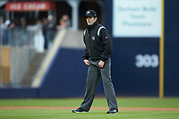 Third base umpire John Bacon works the International League game between the Gwinnett Braves and the Durham Bulls at Durham Bulls Athletic Park on April 20, 2019 in Durham, North Carolina. The Bulls defeated the Braves 11-3 in game one of a double-header. (Brian Westerholt/Four Seam Images)