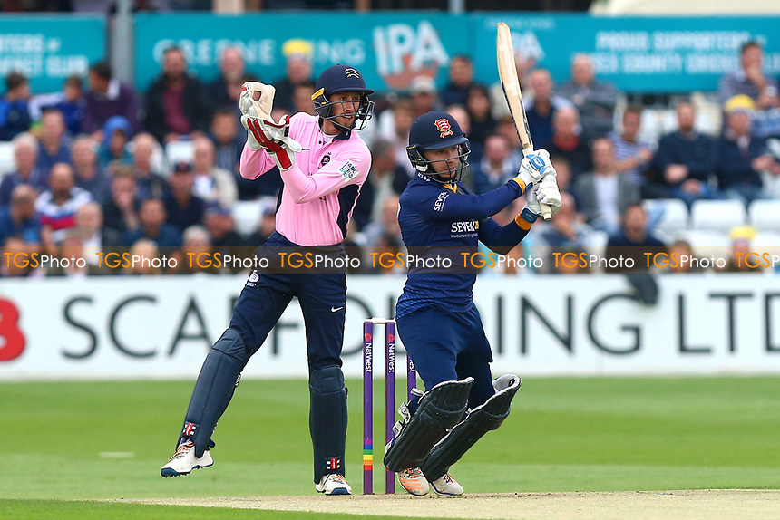 Adam Wheater hits out for Essex as John Simpson looks on from behind the stumps during Essex Eagles vs Middlesex, NatWest T20 Blast Cricket at The Cloudfm County Ground on 11th August 2017