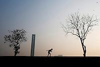 A young Bangladeshi boy uses roller-skates in Dhaka, Bangladesh.