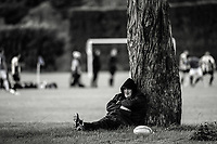 A fan watches the Manawatu premier club rugby match between Varsity and College Old Boys at Massey University in Palmerston North, New Zealand on Saturday, 20 May 2017. Photo: Dave Lintott / lintottphoto.co.nz
