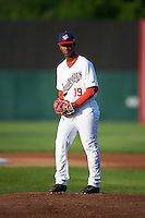 Auburn Doubledays starting pitcher Wilber Pena (19) gets ready to deliver a pitch during a game against the Williamsport Crosscutters on June 25, 2016 at Falcon Park in Auburn, New York.  Auburn defeated Williamsport 5-4.  (Mike Janes/Four Seam Images)