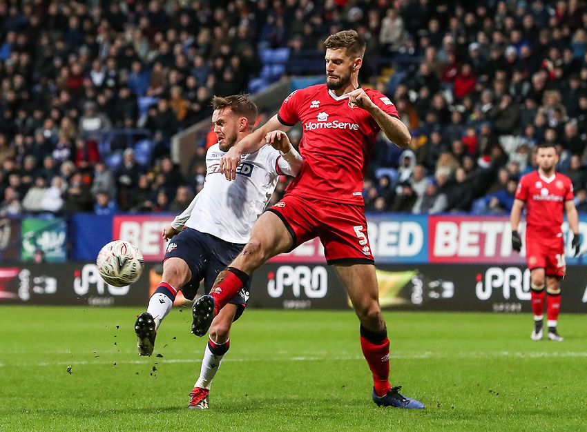 Bolton Wanderers' Craig Noone competing with Walsall's  Jon Guthrie<br /> <br /> Photographer Andrew Kearns/CameraSport<br /> <br /> Emirates FA Cup Third Round - Bolton Wanderers v Walsall - Saturday 5th January 2019 - University of Bolton Stadium - Bolton<br />  <br /> World Copyright © 2019 CameraSport. All rights reserved. 43 Linden Ave. Countesthorpe. Leicester. England. LE8 5PG - Tel: +44 (0) 116 277 4147 - admin@camerasport.com - www.camerasport.com