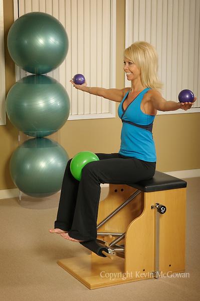 Woman using Pilates equipment