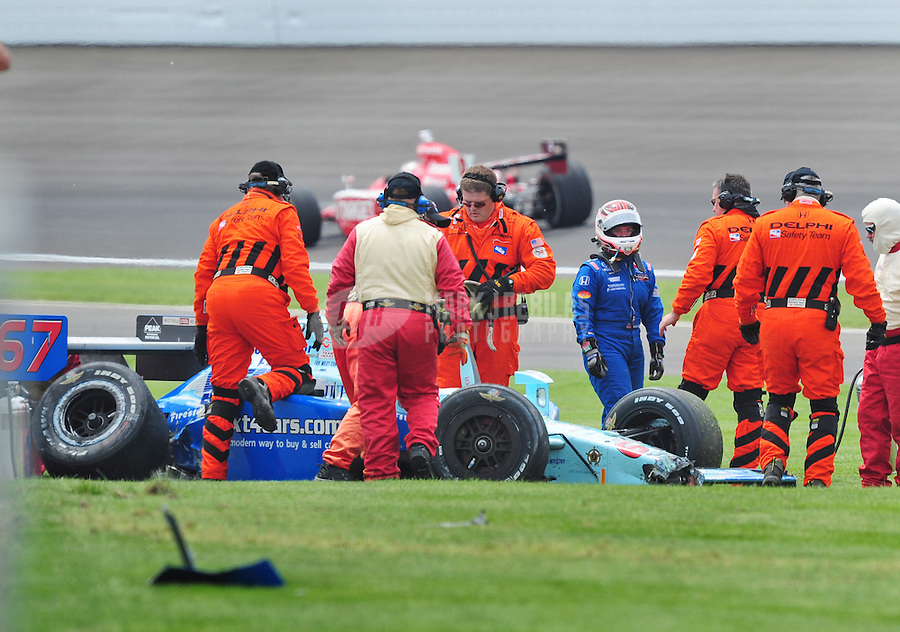 May 25, 2008; Indianapolis, IN, USA; IRL driver Sarah Fisher walks away from her car after crashing during the 92nd running of the Indianapolis 500 at the Indianapolis Motor Speedway. Mandatory Credit: Mark J. Rebilas-