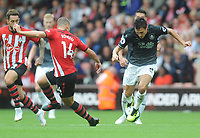 Burnley's Jack Cork under pressure from Southampton's Oriol Romeu<br /> <br /> Photographer Kevin Barnes/CameraSport<br /> <br /> The Premier League - Southampton v Burnley - Sunday August 12th 2018 - St Mary's Stadium - Southampton<br /> <br /> World Copyright &copy; 2018 CameraSport. All rights reserved. 43 Linden Ave. Countesthorpe. Leicester. England. LE8 5PG - Tel: +44 (0) 116 277 4147 - admin@camerasport.com - www.camerasport.com
