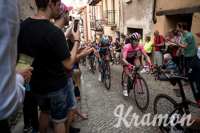 Maglia Rosa / overall leader Valerio Conti (ITA/UAE-Emirates) up the steep, cobbled & crowded climb in Pinerolo<br /> <br /> Stage 12: Cuneo to Pinerolo (158km)<br /> 102nd Giro d'Italia 2019<br /> <br /> ©kramon