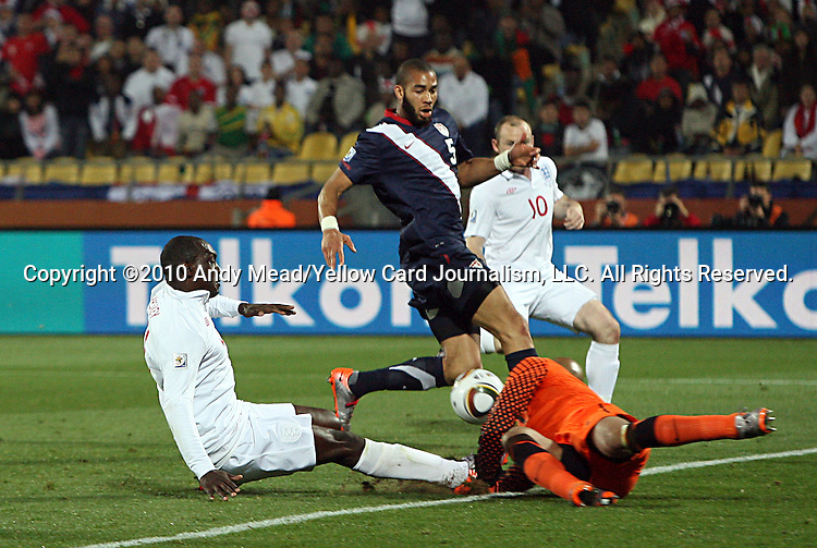 12 JUN 2010:  Emile Heskey (ENG)(center) shoots on goal as Tim Howard (USA)(right) blocks the shot as Wayne Rooney (ENG)(10) and Oguchi Onyewu (USA)(5) follow the play.  The England National Team and the United States National Team were tied 1-1 after the first half at Royal Bafokeng Stadium in Rustenburg, South Africa in a 2010 FIFA World Cup Group C match.