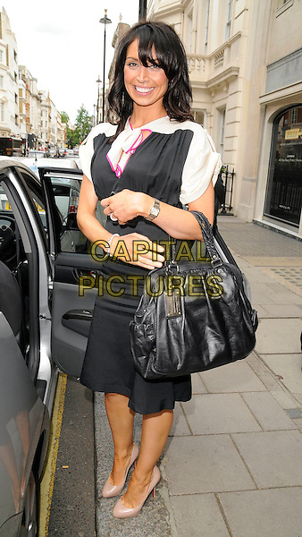 CHRISTINE BLEAKLEY .At the Wondermum Awards, Claridge's Hotel, London, England, May 24th 2009..full length black bag beige Christian Louboutin platform shoes dress scarf neck tie .CAP/CAN.©Can Nguyen/Capital Pictures