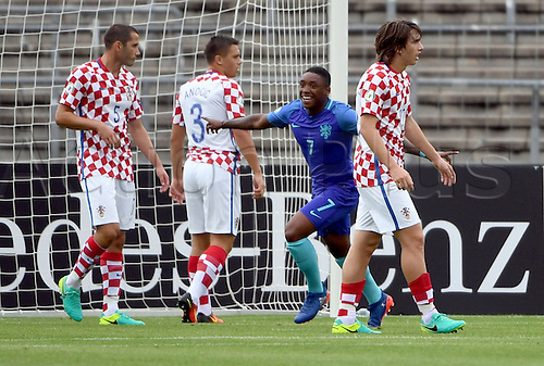 12.07.2016. Donaustadion, Ulm, Germany.  The Netherlands' Steven Bergwijn celebrates after his goal at 0:1, next to Croatia's Vinko Soldo, Silvio Anocic and Andrija Balic, during the UEFA Under-19 European Championship group B match between Croatia and The Netherlands, at the Donaustadion, in Ulm, Germany, 12 July 2016.