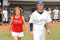 16 May 2010:  FIU's Eric Berkowitz (2) and family make their way onto the field prior to the game as FIU honored its seniors.  The FIU Golden Panthers defeated the University of South Alabama Jaguars, 5-0, at University Park Stadium in Miami, Florida.
