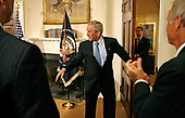 United States President George W. Bush leaves after making a statement to mark the 10th anniversary of the International Religious Freedom Act in the Roosevelt Room of the White House July 14, 2008 in Washington, DC.  Bush listed countries, including China and Vietnam, where the United States has supported and encouraged religious freedom. <br /> Credit: Chip Somodevilla / Pool via CNP