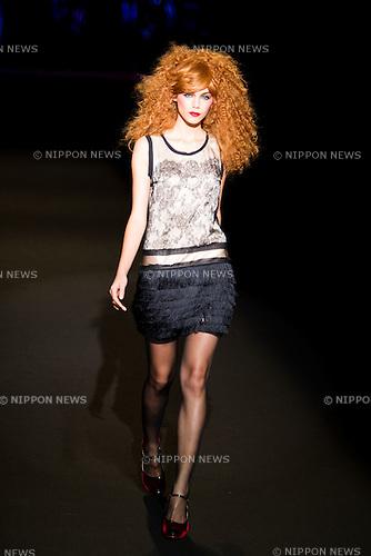 October 17, 2011: Tokyo, Japan - A model walks down the catwalk wearing motonari ono during the Mercedes-Benz Fashion Week Tokyo 2012 S/S. The Mercedes-Benz Fashion Week Tokyo runs from October 16-22. (Photo by Christopher Jue/AFLO)