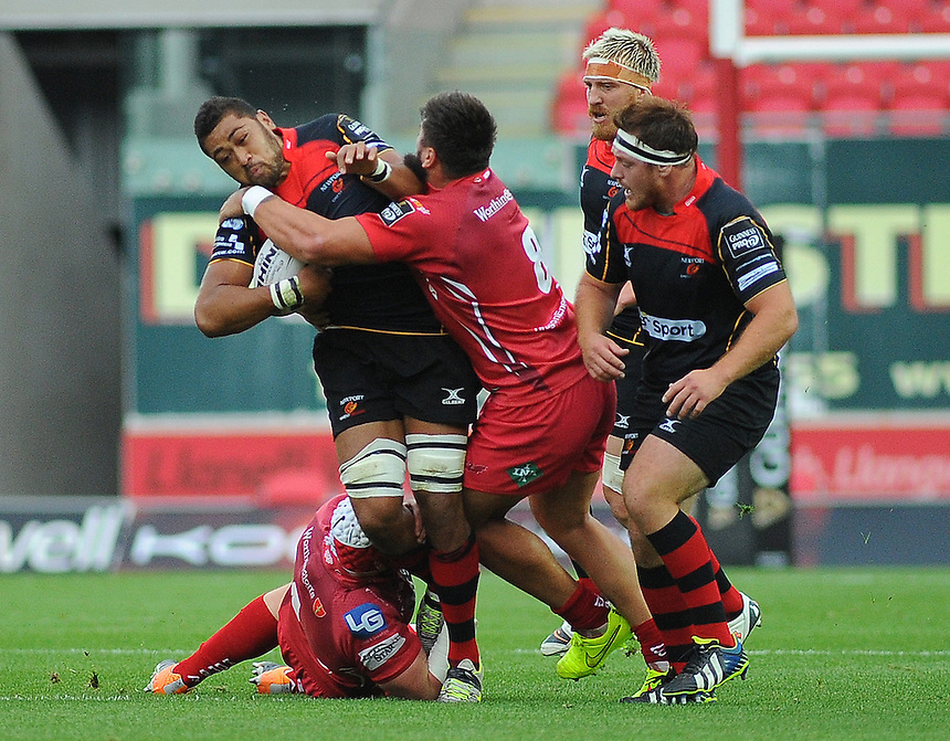 Newport Gwent Dragons' Taulupe Faletau is tackled by Scarlets' Rory Pitman <br /> <br /> Photographer Kevin Barnes/CameraSport<br /> <br /> Rugby Union - Guinness PRO12 - Scarlets v Newport Gwent Dragons - Sunday 05th October 2014 - Parc y Scarlets - Llanelli<br /> <br /> &copy; CameraSport - 43 Linden Ave. Countesthorpe. Leicester. England. LE8 5PG - Tel: +44 (0) 116 277 4147 - admin@camerasport.com - www.camerasport.com