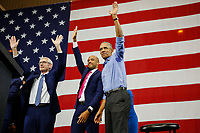 Former U.S. President Barack Obama waves to the crowd during a campaign rally for Democratic candidates Tony Evers (left) and his lieutenant governor Mandela Barnes (middle) at North Division High School in Milwaukee, Wisconsin, October 26, 2018.