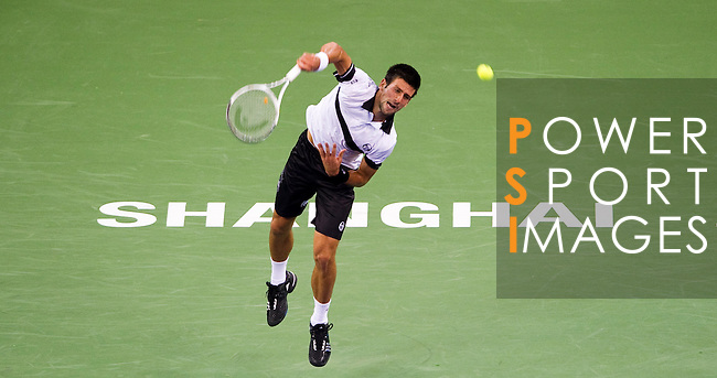 SHANGHAI, CHINA - OCTOBER 14:  Novak Djokovic of Serbia serves to Richard Gasquet of France during day four of the 2010 Shanghai Rolex Masters at the Shanghai Qi Zhong Tennis Center on October 14, 2010 in Shanghai, China.  (Photo by Victor Fraile/The Power of Sport Images) *** Local Caption *** Novak Djokovic