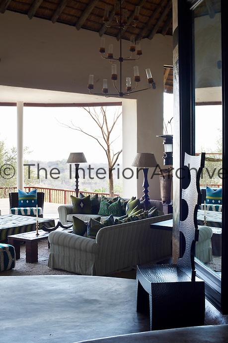 A communal seating area on a covered terrace at Singita Pamushana Lodge, Malilongwe Trust, Zimbabwe