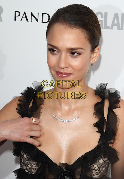 Jessica Alba.Women Of The Year 2012 - Glamour Awards, Berkeley Square, London, England..29th May 2012.headshot portrait black cleavage lace hand ring.CAP/ROS.©Steve Ross/Capital Pictures.