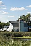 White barn with silo; wetlands, rural eastern North Dakota