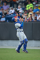 Bluefield Blue Jays catcher Matt Morgan (7) catches a foul pop fly during the game against the Burlington Royals at Burlington Athletic Park on July 1, 2015 in Burlington, North Carolina.  The Royals defeated the Blue Jays 5-4. (Brian Westerholt/Four Seam Images)
