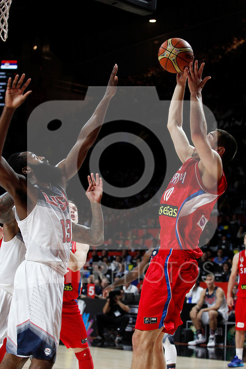 United States´s Harden (L) and Serbia´s Kalinic during FIBA Basketball World Cup Spain 2014 final match between United States and Serbia at `Palacio de los deportes´ stadium in Madrid, Spain. September 14, 2014. (ALTERPHOTOSVictor Blanco)