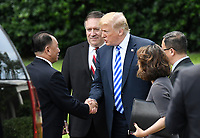 US President Donald Trump shakes hands with Kim Yong Chol, former North Korean military intelligence chief and one of leader Kim Jong Un's closest aides, as Secretary of State Mike Pompeo looks on  outside the  Oval Office of the White House in Washington on Friday, June 1, 2018. <br /> CAP/MPI/RS<br /> &copy;RS/MPI/Capital Pictures