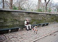 Man sits with dogs on Fifth Avenue outside of Central Park in New York on Saturday, January 7, 2012. (© Richard B. Levine)